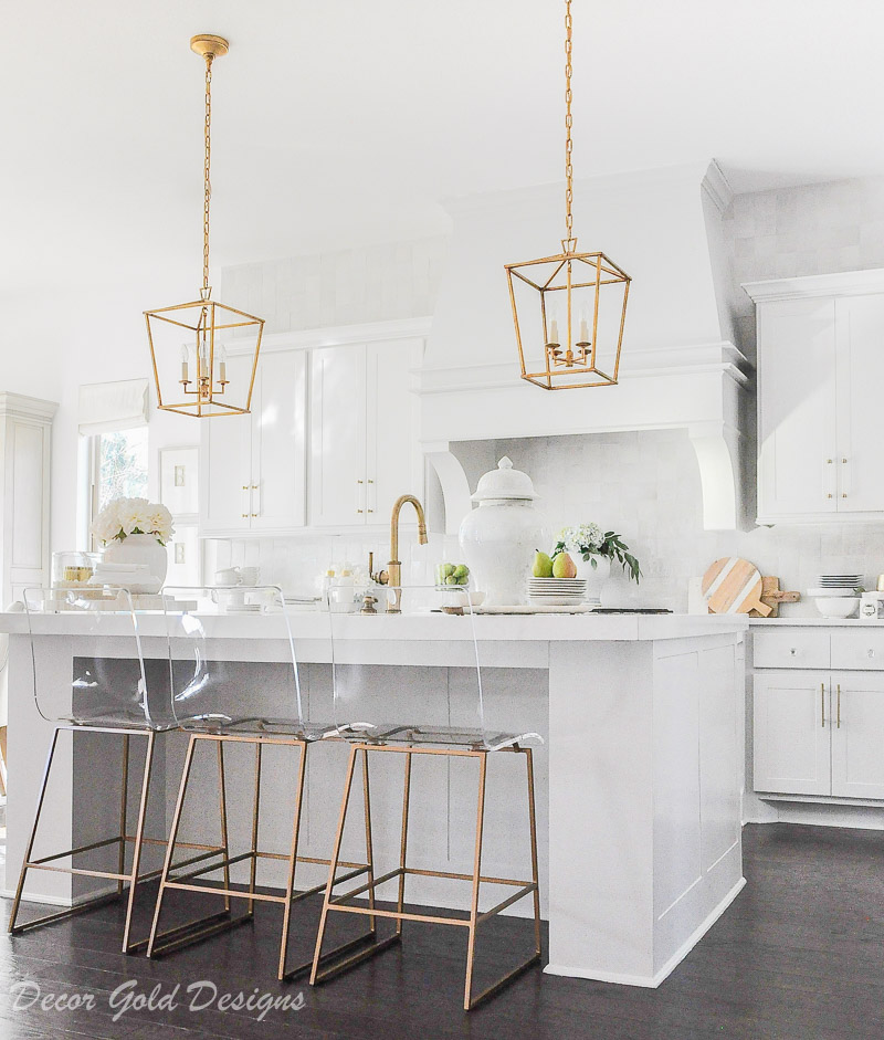 kitchen countertop styling ideas white brass gold accents lucite stools