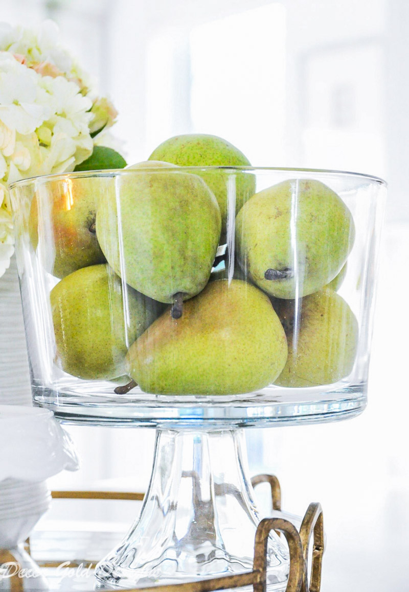 Beautiful kitchen countertop styling ideas. Vignette glass pedestal bowl pears.