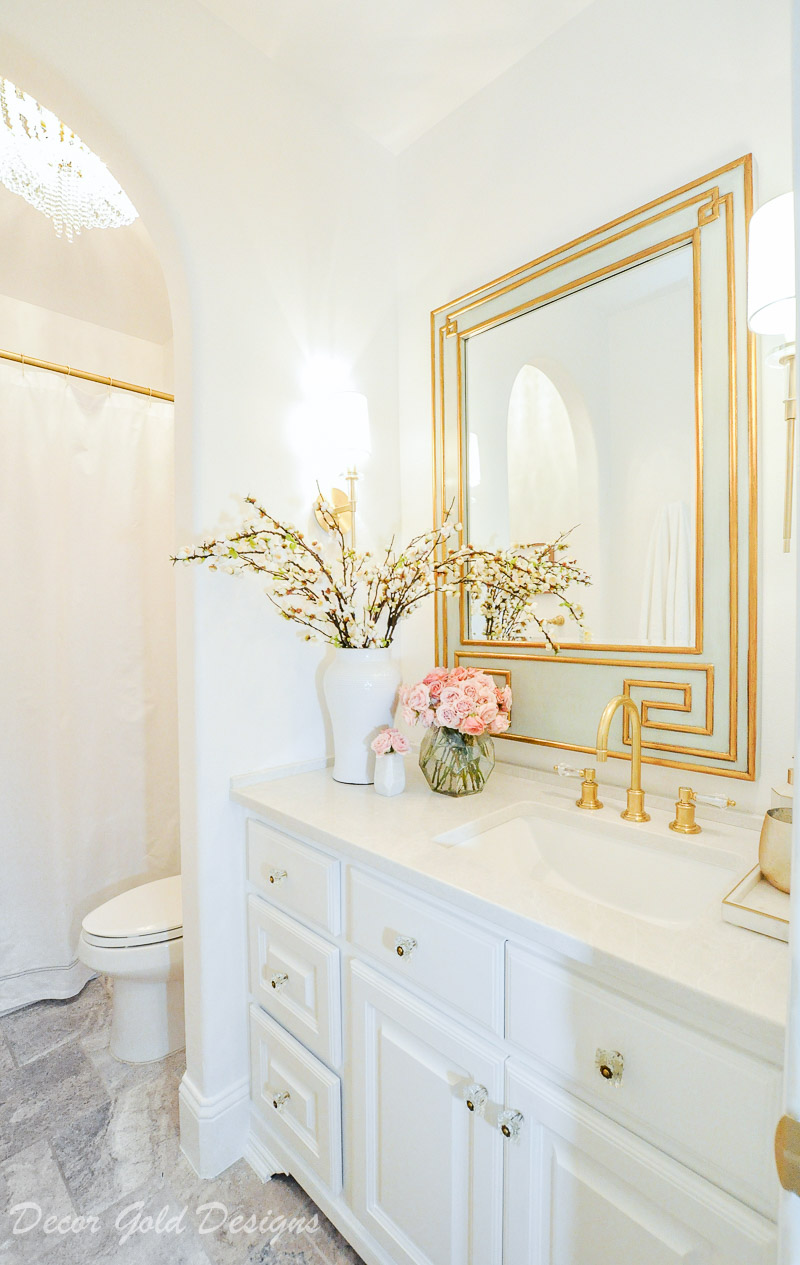 Beautiful powder bathroom bright white walls vanity brass accents
