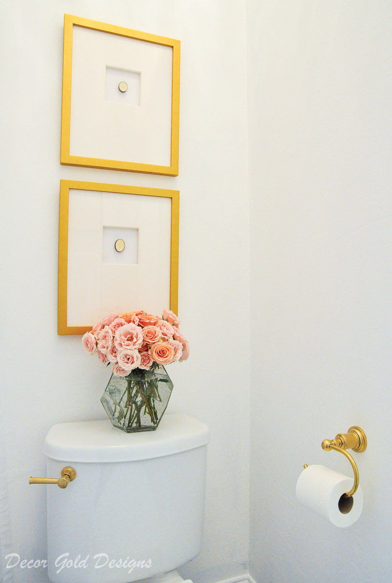 Beautiful powder bathroom brass accents art framed intaglios