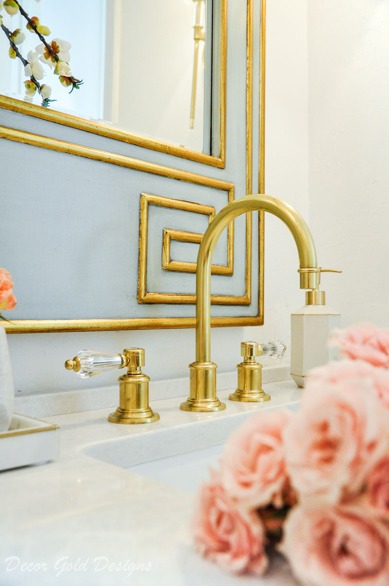 Gorgeous powder bathroom mirror faucet details