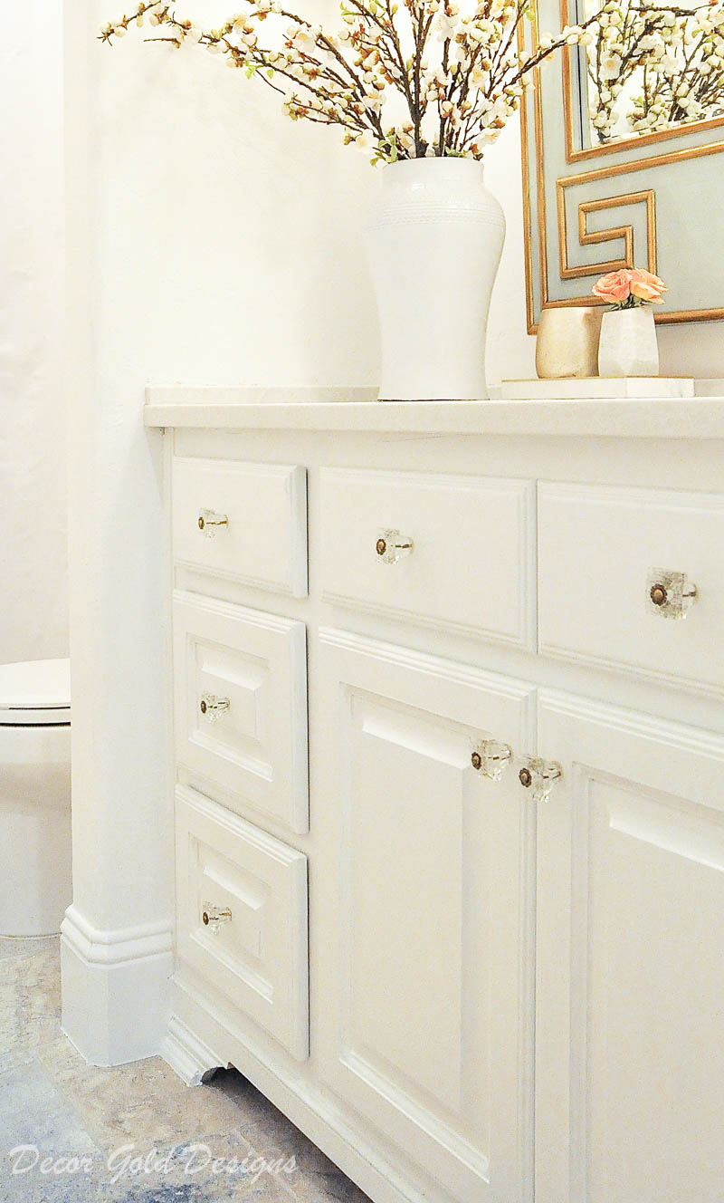 Powder bathroom white painted vanity glass hardware