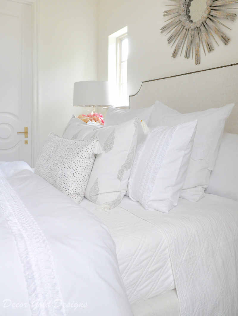 Beautiful designer bedroom white layered bedding