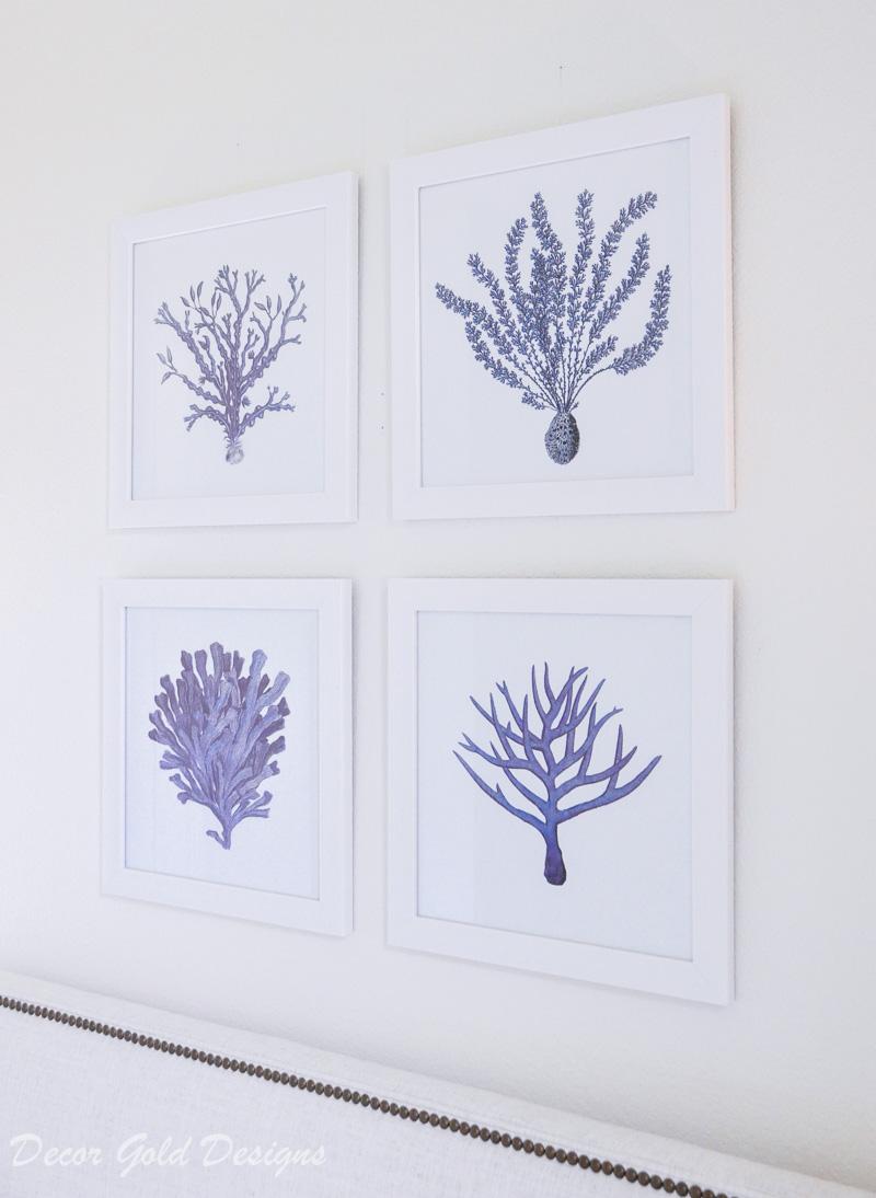 Coastal bedroom whites soft blue art