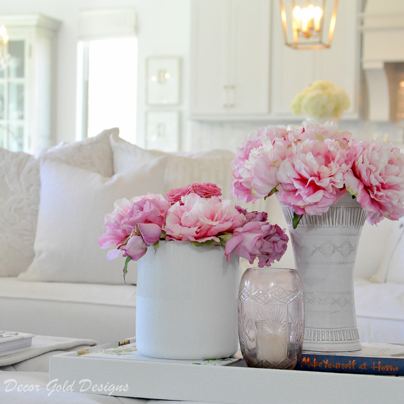 Coffee table styling pink flowers white vases