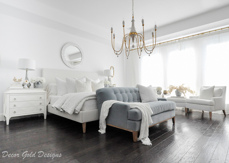 Master bedroom refresh white bed gold chandelier blue sofa