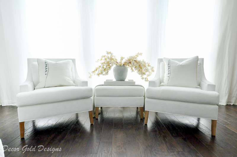 Master bedroom refresh white chairs ottoman