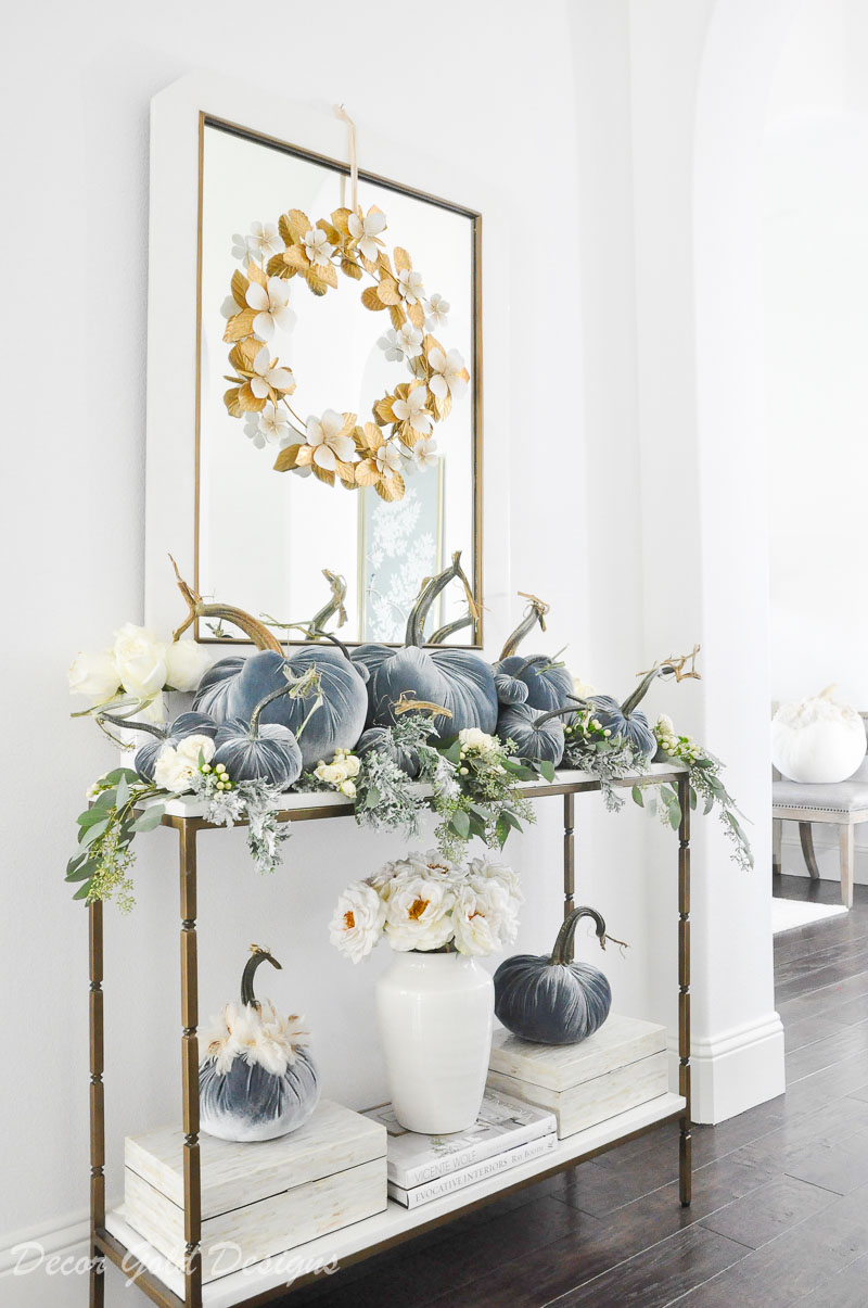 Beautiful pumpkin styling blue velvet pumpkins white console table
