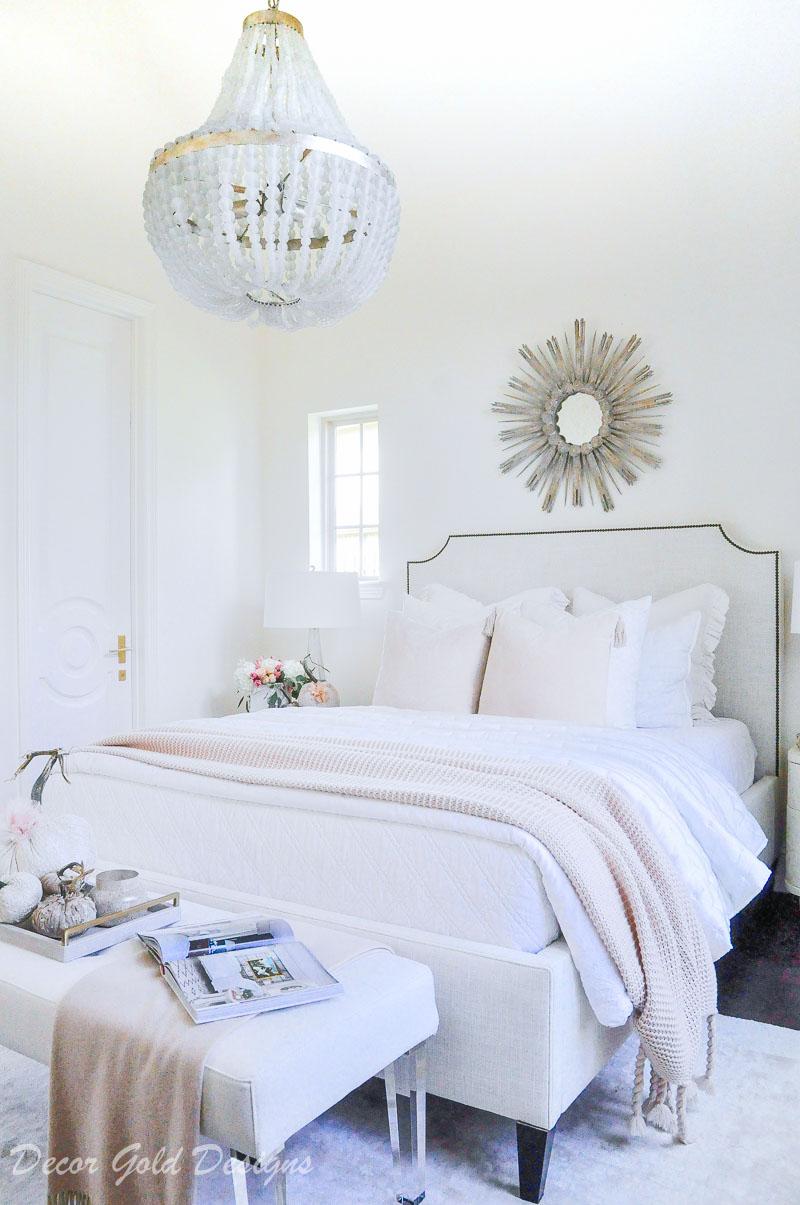 Subtle fall bedroom white pink bed feminine decor