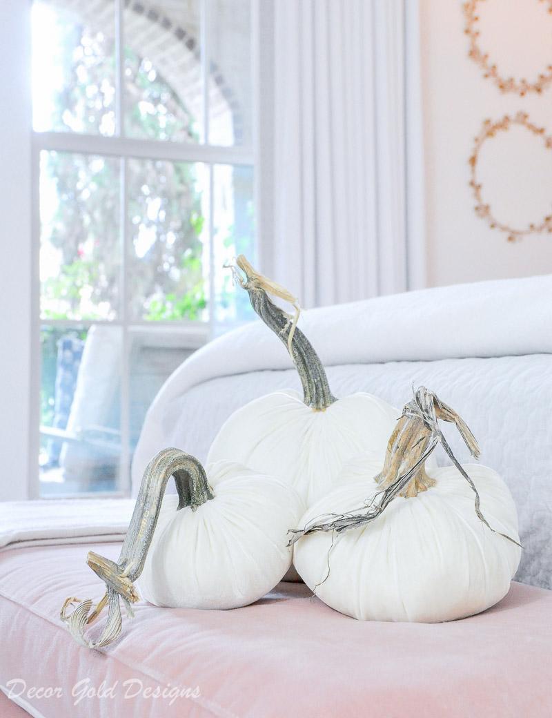 Subtle fall bedroom white velvet pumpkin decor