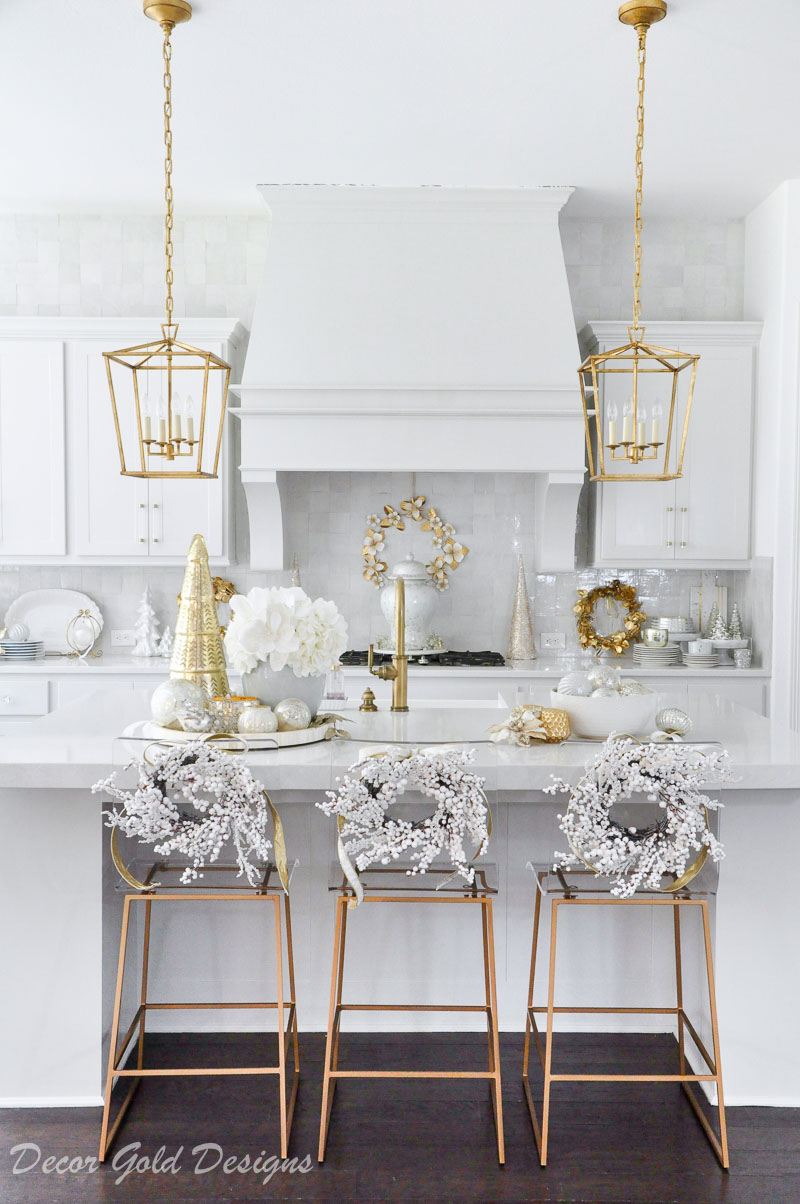Bright cheerful Christmas kitchen decorated white berry wreaths gold accents