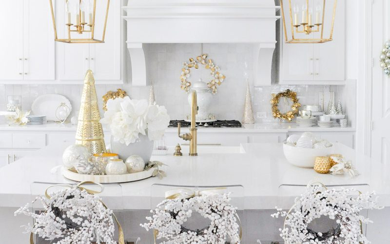 Bright cheerful Christmas kitchen decorated white berry wreaths