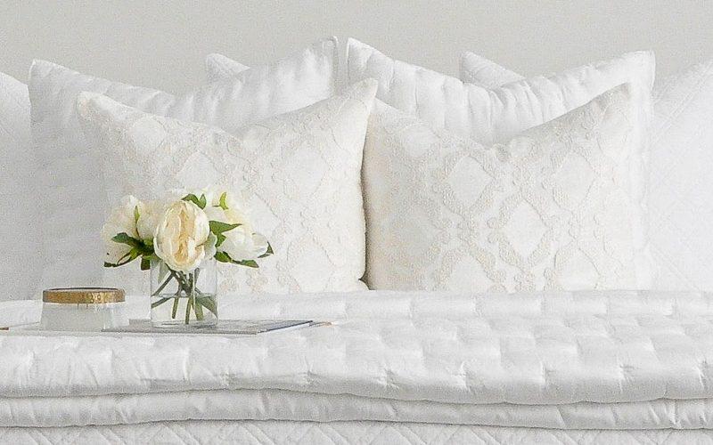 master bedroom white pillows bedding