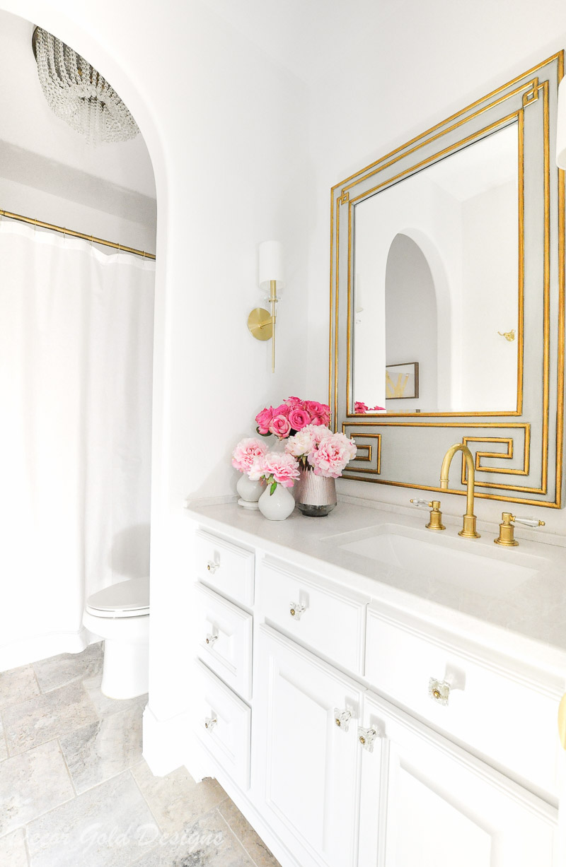 Powder bath beautiful white walls vanity brass accents