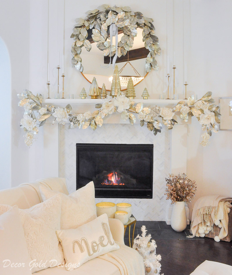 Decorated Christmas living room white gold mantel