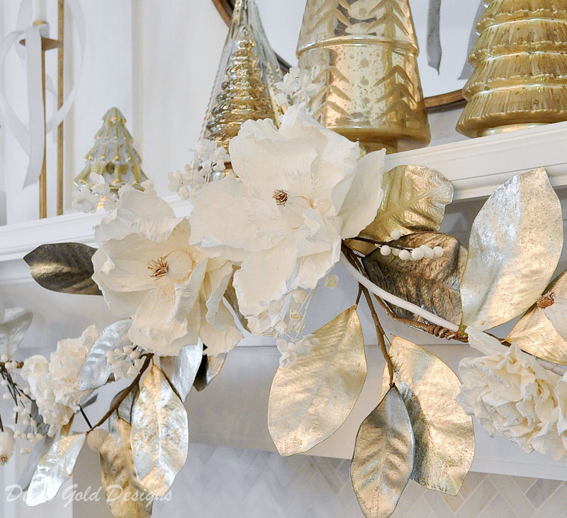 White Christmas living room gold garland mantel