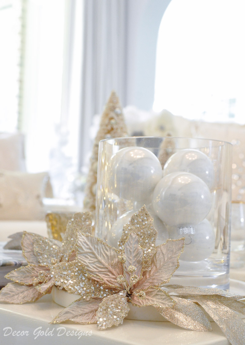White ornaments hurricane Christmas living room decor