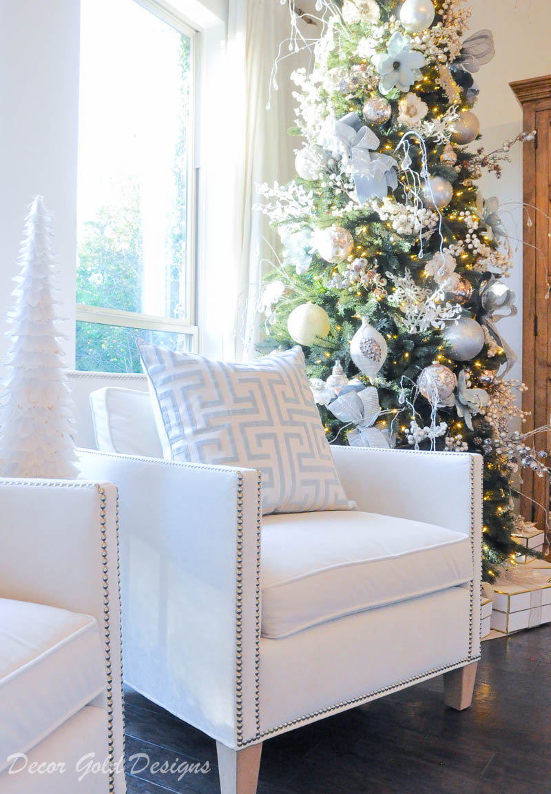Christmas bedroom white chair beautiful tree