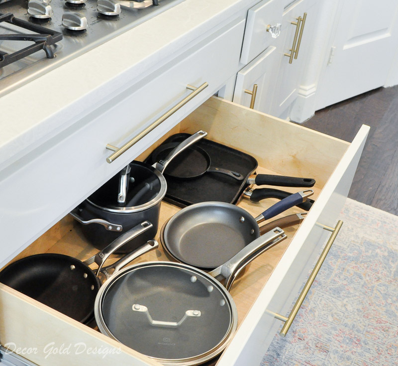 Kitchen organization project with a large drawer containing pots pans