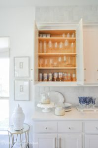 Kitchen organization project showing an upper cabinet glassware inside