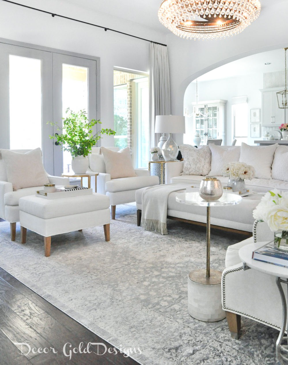 Spring home tour living room white furnishings bright green branches