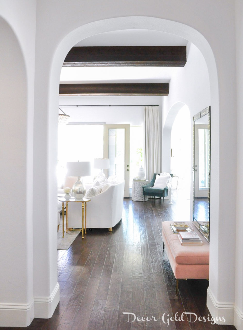 Spring home tour blush pink bench entryway arches beams