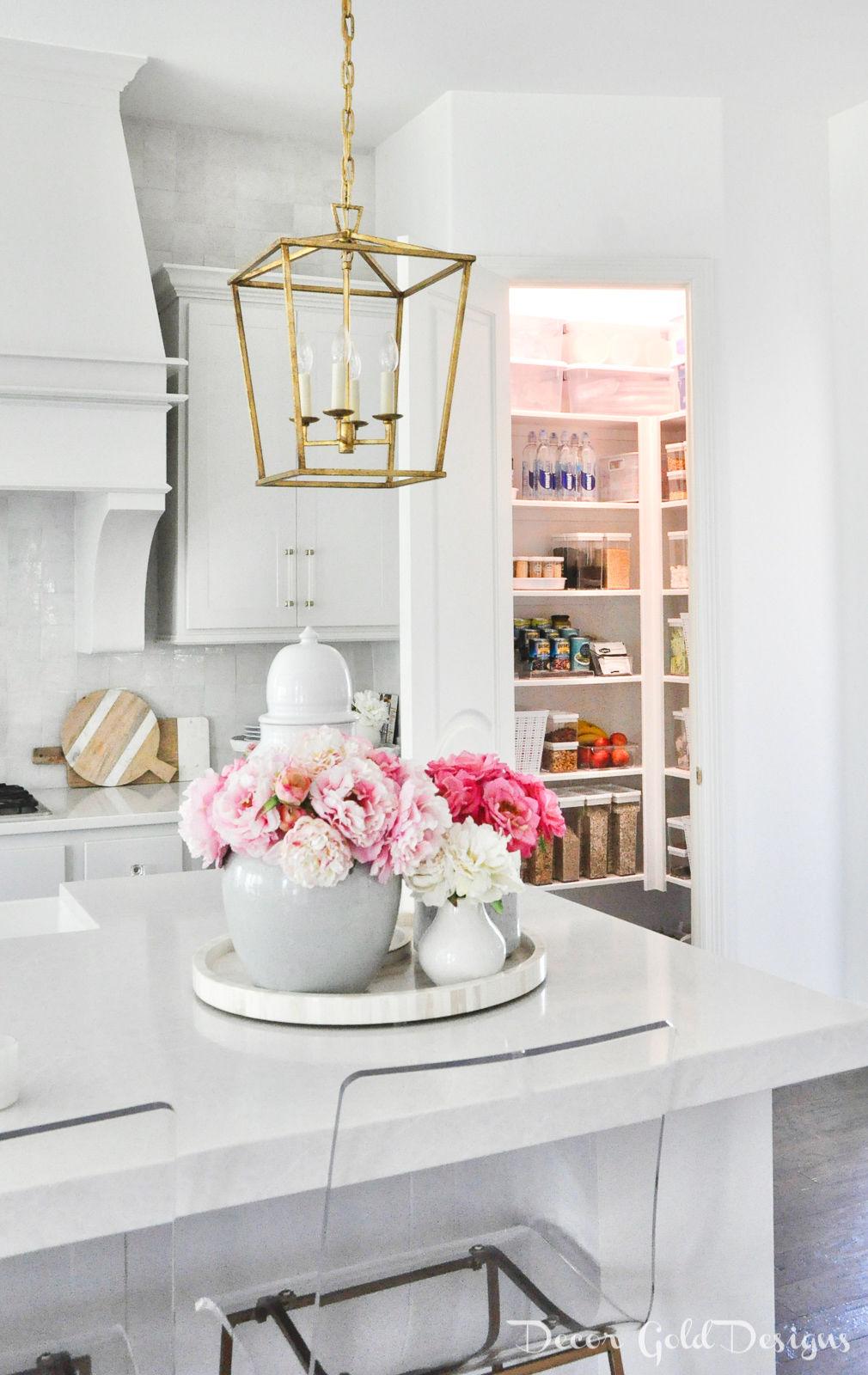 Bright organized corner pantry in a white kitchen