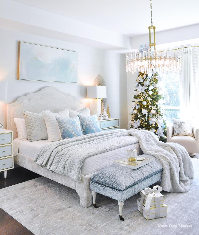 Christmas bedroom in pastels with a beautifully decorated tree