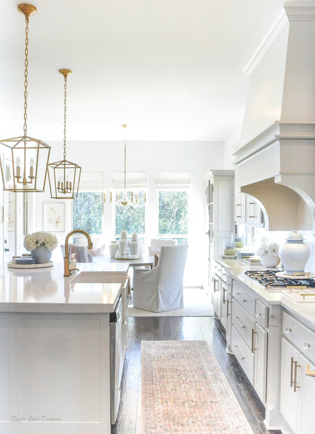 Winter white kitchen gold accents dining area