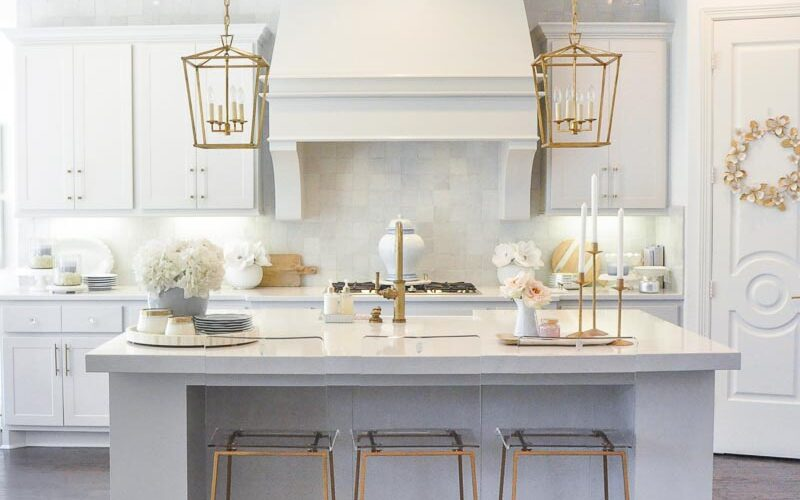 Winter white kitchen gold accents dining stools