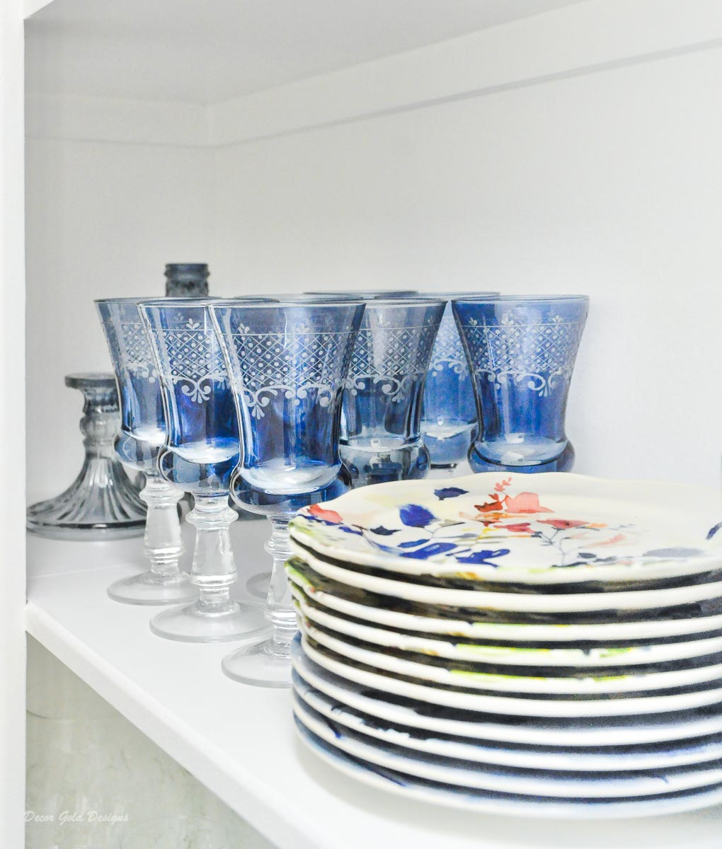 Entertaining closet blue glassware floral plates