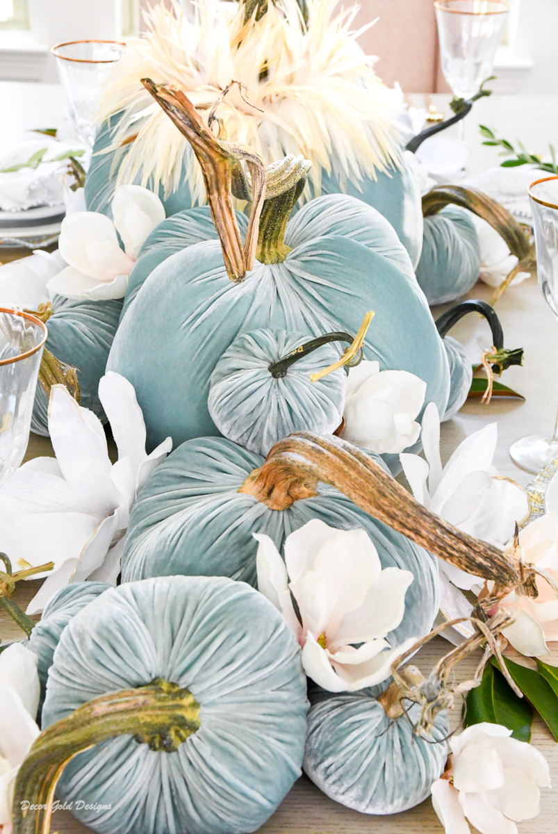 Elegant blue velvet pumpkin centerpiece magnolia flowers