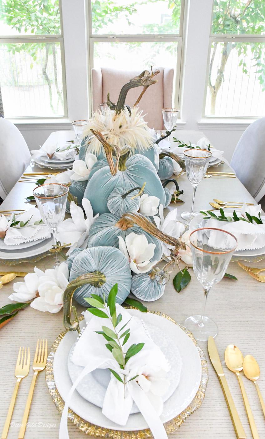 Elegant velvet pumpkin centerpiece blue magnolias