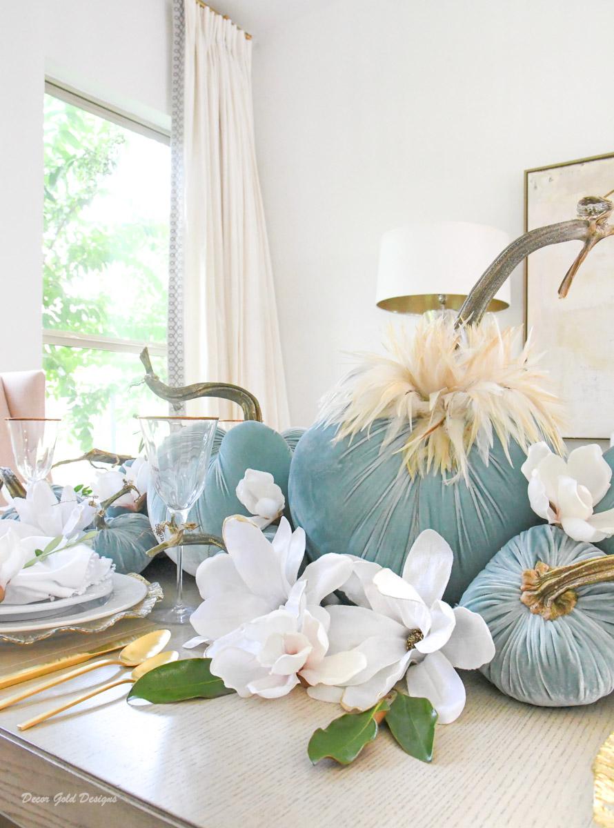 elegant fall pumpkin centerpiece magnolias