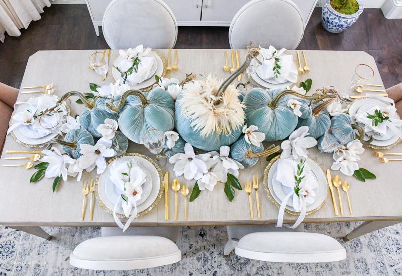 Elegant fall pumpkin centerpiece and magnolias beautiful place settings
